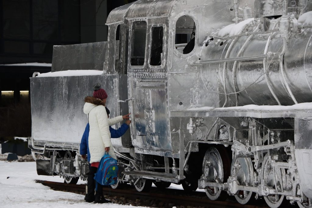 Mother and son touch locomotive
