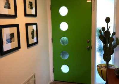 1957 Green door with portholes